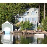 Lake Sunapee lakefront home with a boat house for sale