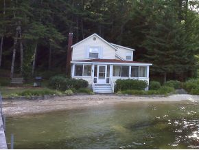 Level .96 acre lot with sandy beach