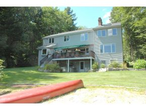 Winnipesaukee home for sale with a sandy beach