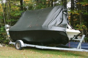 My Boat Stored in the Back Yard under a Tarp