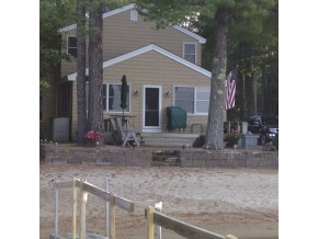 ossipee lake home with sandy beach